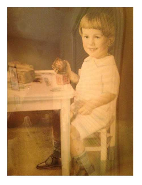 vintage photo of the author's father as a child playing with blocks
