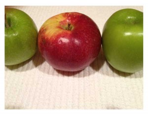a row of apples, 2 green and one red
