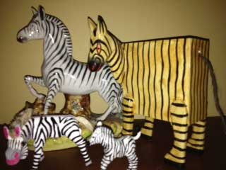 a collection of toy zebras